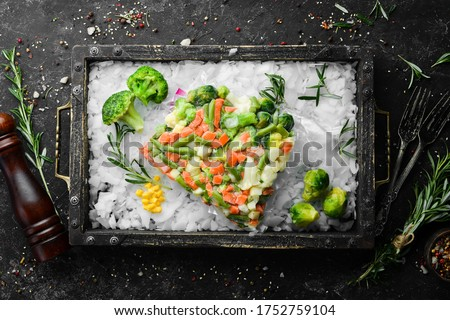 Assortment of frozen vegetables on ice. Stocks of food. Top view. Free space for your text. Royalty-Free Stock Photo #1752759104