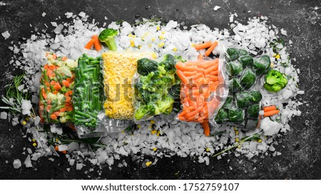 Assortment of frozen vegetables on ice. Stocks of food. Top view. Free space for your text. Royalty-Free Stock Photo #1752759107
