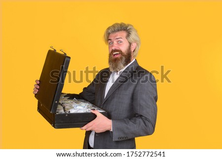 Happy businessman holds briefcase with money. Bearded man with case of money. Money for business. Dollar currency cash. Wealth and rich. Lending business. Money for entrepreneur. Man took loan. #1752772541