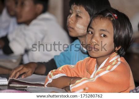 INDIEN VILLAGE, MYANMAR - NOVEMBER 3; Asian children in class in a village school on November 3 2013, in Indien Village, Myanmar. #175280762