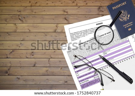 Department of State form DS60 Affidavit Regarding a change of name lies on table and ready to fill. Paperwork during operations with US Passport concept. Flat lay top view Royalty-Free Stock Photo #1752840737