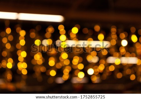 Blurry lights of urban Christmas illumination. Golden bokeh, abstract background