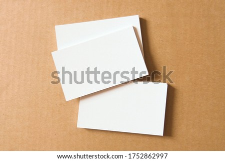 Business card on colored background. Blank name card for company logo,  Branding Mock-up. Flat lay. Copy space for text