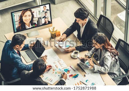 Video call group business people meeting on virtual workplace or remote office. Telework conference call using smart video technology to communicate colleague in professional corporate business. #1752871988