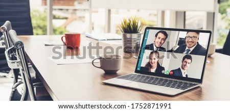 Video call business people meeting on virtual workplace or remote office. Telework conference call using smart video technology to communicate colleague in professional corporate business. #1752871991