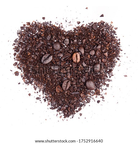 Coffee bean broken crushed splash isolated on white background top view heart shape object photo hi resolution
