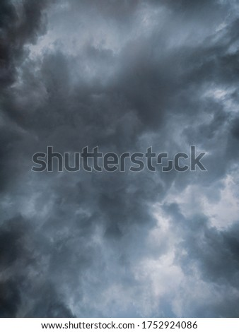 Light in the Dark and Dramatic Storm Clouds background,before the rain