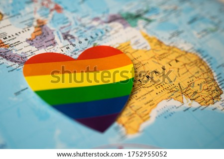 Rainbow color heart on Australia globe world map background, symbol of LGBT pride month  celebrate annual in June social, symbol of gay, lesbian, gay, bisexual, transgender, human rights and peace.