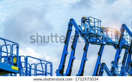 Articulated boom lift. Aerial platform lift. Telescopic boom lift against blue sky. Mobile construction crane for rent and sale. Maintenance and repair hydraulic boom lift service. Crane dealership.  #1752973034