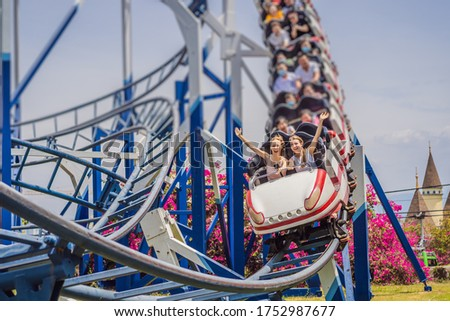Happy friends in amusement park on a summer day Royalty-Free Stock Photo #1752987677