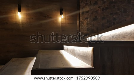 Illuminated staircase with wooden steps and illuminated at night in the interior of a large house Royalty-Free Stock Photo #1752990509