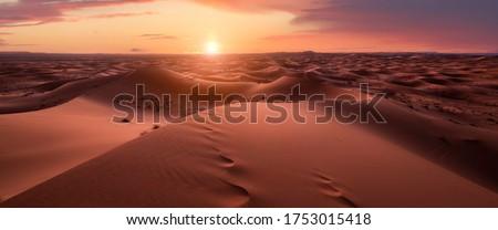 Sunset panorama in the desert. Dunes Erg Chebbi in the Sahara desert near Merzouga, Morocco , Africa. Beautiful sand landscape with stunning sky. Royalty-Free Stock Photo #1753015418