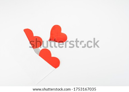 Open envelope and three red paper hearts on a white background with place for text Royalty-Free Stock Photo #1753167035