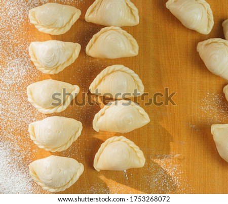 An picture top down the raw material for make Curry puff Thai desserts which are preparing for frying.