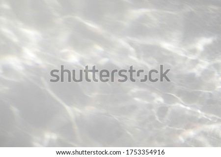 Water texture overlay effect for photo and mockups. Organic drop diagonal shadow and light caustic effect on a white wall. Shadows for natural light effects #1753354916