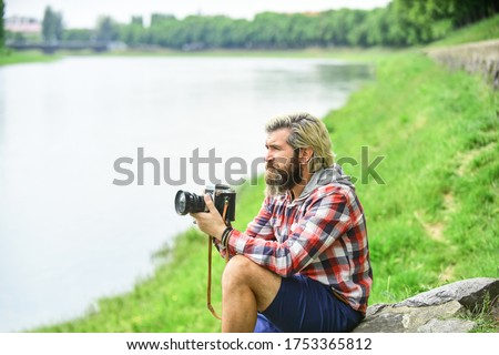 This is the life. travel tips. professional photographer use vintage camera. bearded man hipster take photo. photo shooting outdoor. brutal man traveler with retro camera. photography in modern life.