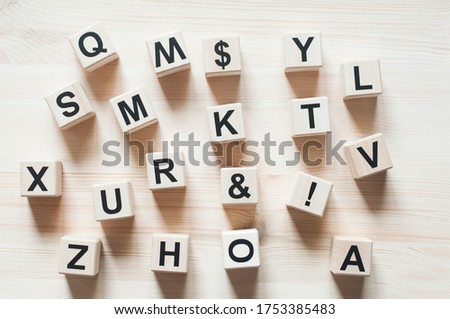 Wooden cubes. The letters are scattered. Alphabet. 3D figures #1753385483