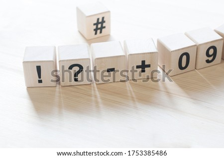 Wooden cubes. The letters are scattered. Alphabet. 3D figures #1753385486