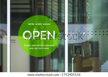 Open store, sign on the front door after quarantine. Welcome back! We are work again. Please, keep social distance and use face mask.