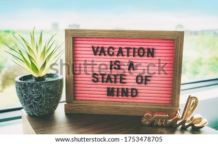 Vacation is a state of mind positive inspirational quote text on message board for summer holidays travel plans cancelled due to COVID-19 coronavirus. Staycation pink felt board text for staying home. #1753478705
