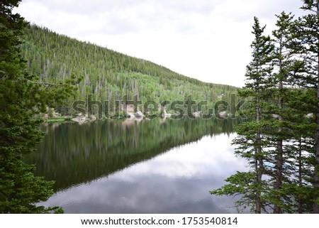 Reflection of the Tree Line in Estes Park, Colorado #1753540814