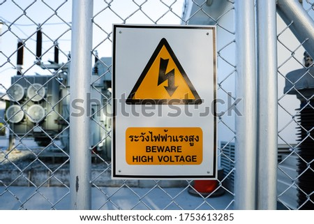"Warning Sign and Symbol Caution Signboard on Fence of Electrical Power Substation that show "" BEWARE HIGH VOLTAGE """