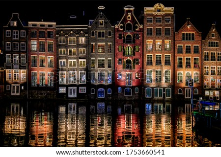 Night city river houses reflection in water. Night lights Holland river city. Town houses reflection in night river water. River houses night lights #1753660541