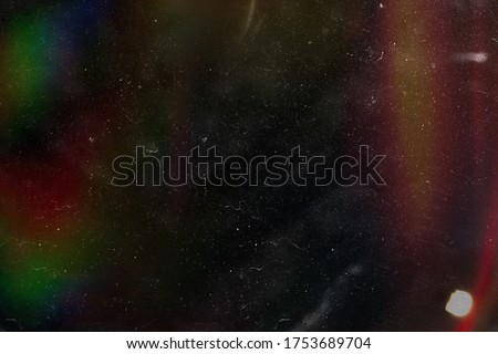 Designed film texture background with heavy grain, dust and a light leak Real Lens Flare Shot in Studio over Black Background. Easy to add as Overlay or Screen Filter over Photos overlay Royalty-Free Stock Photo #1753689704