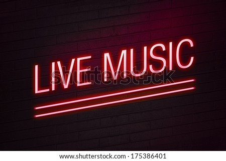 Red neon sign with live music text on wall glow