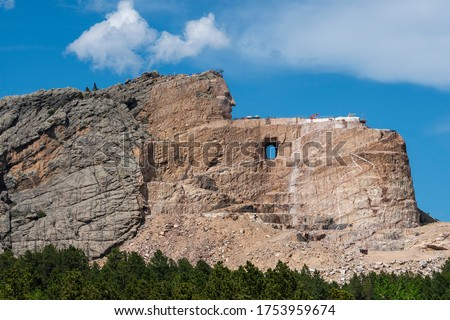 The face of the famous Native American Chief Crazy Horse begins to emerge from an ongoing construction project at a stone mountain in South Dakota. Royalty-Free Stock Photo #1753959674