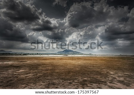 widely field, mountain and cloud in dramatic Royalty-Free Stock Photo #175397567