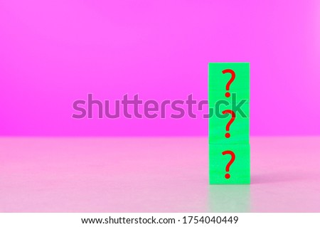 wooden block in question mark sign mean what on vivid colorful background wood cube business teamwork concept