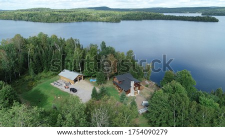 Major island on campion Lake aerial pictures from drone. Pictures represent the lake and the island with nearby cottage