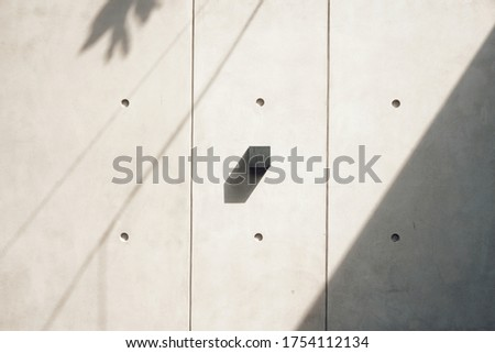 Shadow of a box hanging on a wall as symbol of minimalism. Minimalist background. Minimalist concept photos. Minimalism concept.