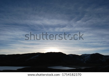 Sunset on Bolivian high mountain #1754182370