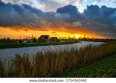 Rural sunset river village landscape. Sunset river village view. River village sunset scene. Sunset river village #1754365460
