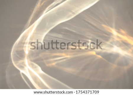 Blurred rainbow light refraction texture overlay effect for photo and mockups. Organic drop diagonal holographic flare on a white wall. Shadows for natural light effects Royalty-Free Stock Photo #1754371709