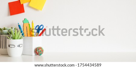 Student's desk. Creative workspace front view. Royalty-Free Stock Photo #1754434589