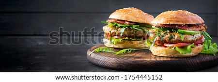 Big sandwich - hamburger burger with turkey meat,  tomato,  bacon and lettuce. Banner #1754445152