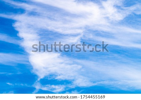 white bright veil clouds on blue sky as background picture