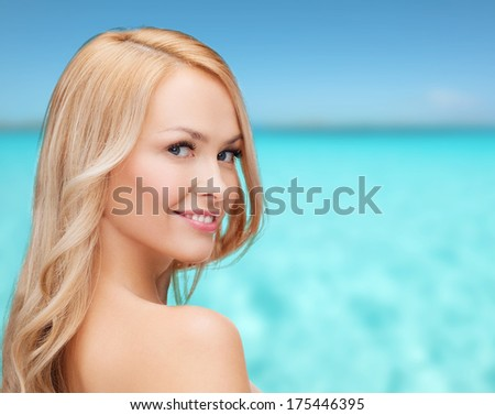 health and beauty concept - face and shoulders of happy woman with long hair #175446395