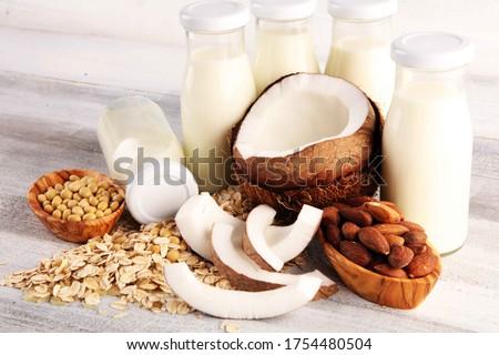 Various vegan plant based milk alternatives and ingredients. Dairy free milk substitute drink, healthy eating.  Royalty-Free Stock Photo #1754480504