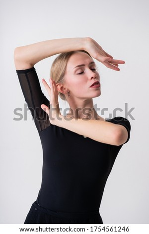 Picture of beautiful young fit woman doing sport exercises in big bright white studio