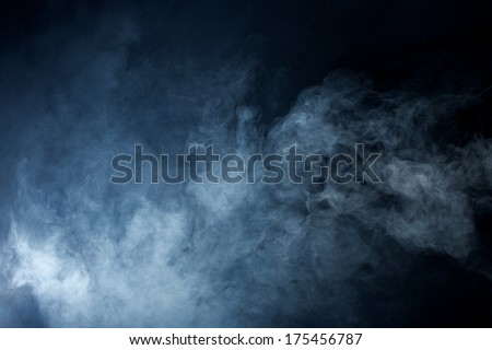 Fluffy Puffs of Smoke and Fog on Black Background