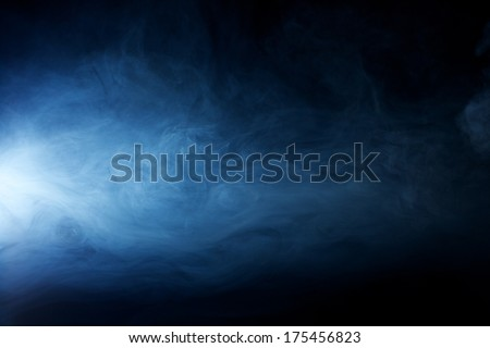 Mysterious, Solemn, Hazy fog patterns lit by a beam of light Royalty-Free Stock Photo #175456823
