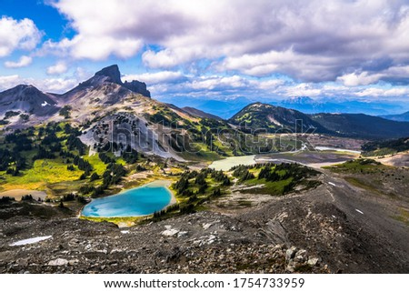 Black tusk mountain with turquoise blue lake and valley scene Royalty-Free Stock Photo #1754733959