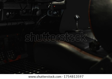 Driving simulator. Focus on gear changer on black background