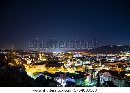 Germany, Magical starry sky old town buildings of medieval city esslingen am neckar, aerial view above the houses and roof by night #1754839583