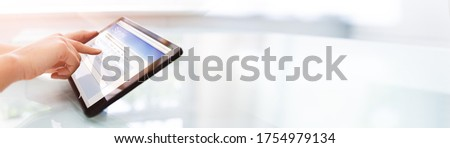 Filling Online Survey Form Or Questionnaire Poll On Tablet Royalty-Free Stock Photo #1754979134