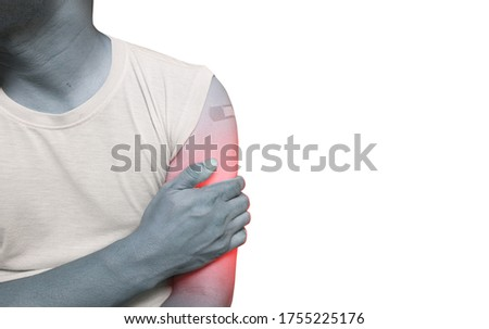 Close up Acute pain in a man from behind holding hand spot of Upper arm pain.Concept photo with Color Enhanced blue skin with red spot indicating location of the pain.Medical healthcare concept.